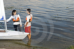 Couple Next To Sailboat On Water - Horizontal Stock Photo - Image: 5842460