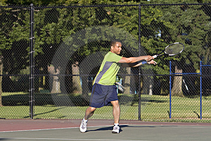 Man on Tennis Court Playing Tennis Royalty Free Stock Photography