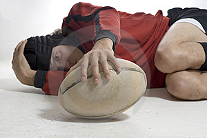 Man Laying On Floor Holding Rugby Ball - Horizonta Stock Photo - Image: 5849500