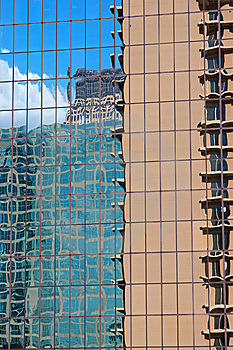 Buildings Reflecting In A Skyscraper Royalty Free Stock Photo - Image: 5852045