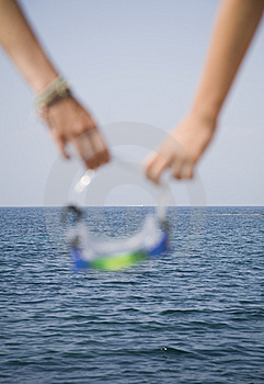 Goggles In Hand Royalty Free Stock Photography - Image: 5881587