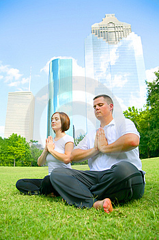Couple Meditating In Downtown Stock Photography - Image: 5884182