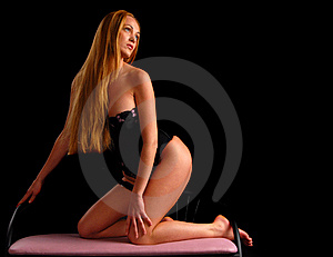 Sexy blond girl on a chair Stock Photo