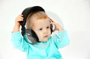 Baby and head-phones Royalty Free Stock Image