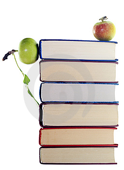 Apples on stack of books Free Stock Photo