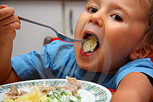 Young Boy Indoors Eating Royalty Free Stock Photos - Image: 5934548