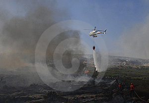 Fire With Combat Helicopter Royalty Free Stock Image - Image: 5945956