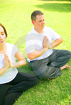 Young Couple Meditate In Park Stock Photo - Image: 5958340
