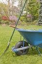 Wheelbarrow and  Rake Stock Photos