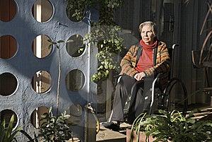 Elderly Woman Sitting in Wheelchair - Horizontal