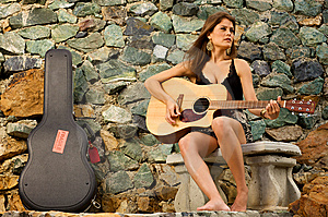 Pretty female singer playing guitar. Free Stock Photography