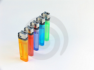 Five lighters in a row Royalty Free Stock Photography