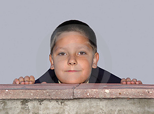 Boy Behind The Fence Stock Image