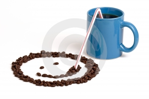 Smiley Face Sipping Coffee Royalty Free Stock Photo
