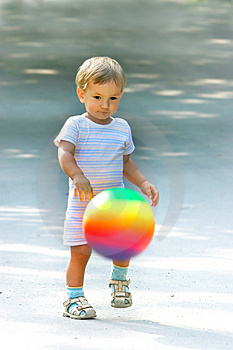 Boy With Colorful Ball Royalty Free Stock Photos - Image: 6008648