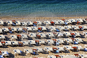 Empty Chaise Lounges On A Morning Beach Royalty Free Stock Images - Image: 6018769