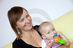Smiling mother with baby Free Stock Images