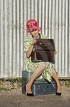 Woman With Pink Hair And A Small Siuitcases Royalty Free Stock Photo - Image: 6040525