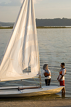 Couple Standing Next To Sailboat - Vertical Royalty Free Stock Photos - Image: 6040858