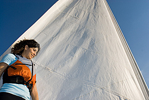 Woman Standing Against Sail On Boat - Horizontal Royalty Free Stock Image - Image: 6040966