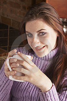 Smiling Girl Holding White Mug With Both Hands Stock Image - Image: 6068701