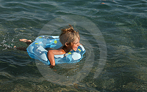 Girl Floats On A Lifebuoy Ring Royalty Free Stock Photography - Image: 6082257