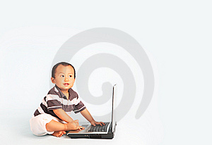 Happy Toddler Using A Laptop Royalty Free Stock Images - Image: 6082969