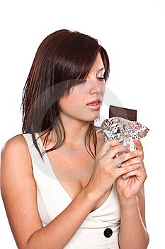 The Young Beautiful Girl Eats Chocolate. Royalty Free Stock Photos - Image: 6101628