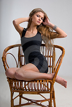 Slim Girl On A Chair Royalty Free Stock Image - Image: 6103406