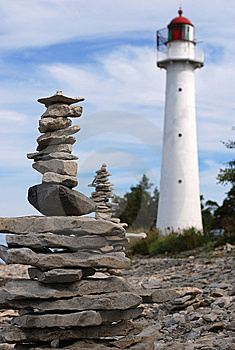 Lighthouse And Stones Stock Photo - Image: 6104870