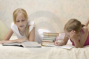 Two sisters do homework Free Stock Photos