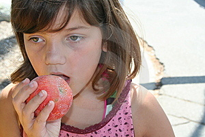 Girl Taking A Bite Stock Images - Image: 6118484