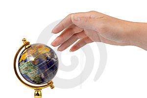 Hand And Spinning Globe Stock Image - Image: 6119081