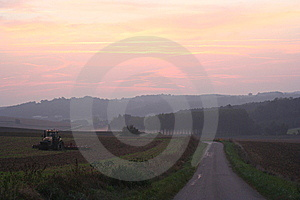 Tractor At Dawn Royalty Free Stock Photos - Image: 6128158