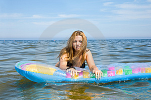 Beautiful Girl Swimming On Mattress Royalty Free Stock Images - Image: 6132369