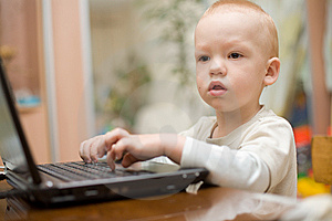 Little Boy Typing Text On Laptop At Home Royalty Free Stock Image - Image: 6139906