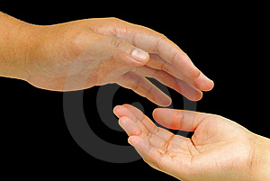 A hand trying to hold another hand Stock Images