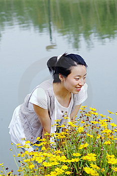 Young Girl Smell Flowers Royalty Free Stock Images - Image: 6161169