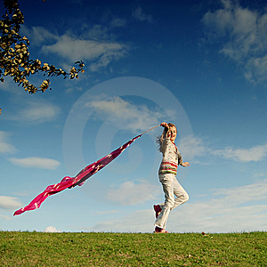 Girl having fun in a park Royalty Free Stock Image