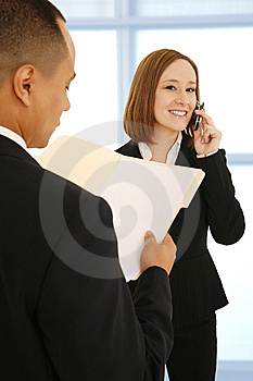 On The Phone During Meeting Stock Photo