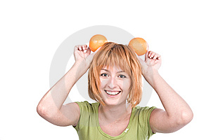The Young Woman With Red Hair Holds Two Oranges Royalty Free Stock Photo - Image: 6185575