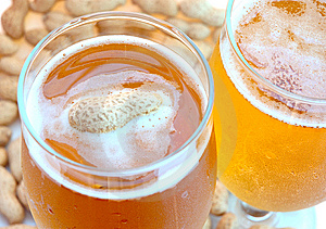 Beer In Glass  And Peanuts  In Shells. Stock Photo - Image: 6187390