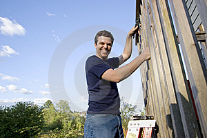 Man Repairing Siding - Horizontal Stock Photo - Image: 6202090