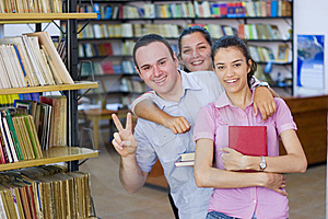 Three students in library Stock Photo