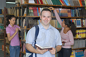 Three students in library Stock Photos