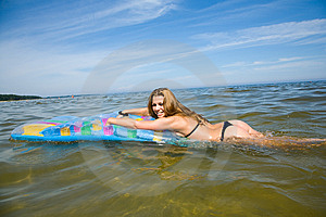 Beautiful Girl Swimming On Mattress Stock Image - Image: 6204051