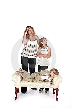 Mother And Daugheter Laughing At Boy On Couch Royalty Free Stock Photo - Image: 6206975
