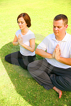 Two Caucasian Meditate On Grass Royalty Free Stock Photo - Image: 6209335