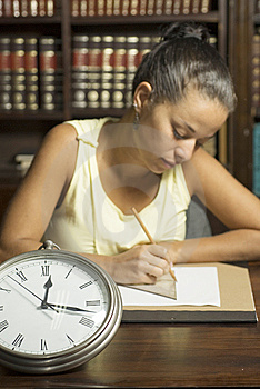 Woman Seated By Clock Royalty Free Stock Photos - Image: 6213248