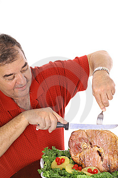 Grandfather Slicing A Ham Vertical Stock Photo - Image: 6237370